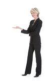 Businesswoman gesturing on white background Stock Photo