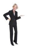 Businesswoman gesturing on white background Stock Photo
