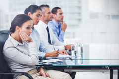 Businesswoman getting bored while attending presentation Stock Images