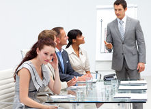 Businesswoman getting bored in a presentation Royalty Free Stock Photos