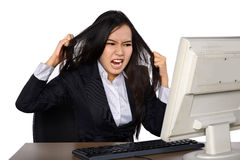 Businesswoman getting crazy in front of her laptop Royalty Free Stock Photos