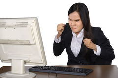 Businesswoman getting crazy in front of her laptop Royalty Free Stock Photography