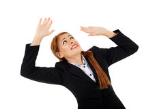 Businesswoman getting crushed by an invisible object Stock Image