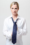 Businesswoman getting dressed Stock Images