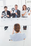 Businesswoman getting her interview rating Stock Photo
