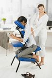 Businesswoman getting massage in office Royalty Free Stock Image