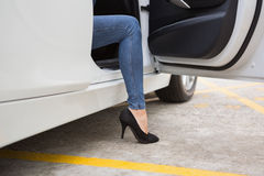 Businesswoman getting out the front door Royalty Free Stock Photos