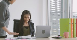 Businesswoman getting rebuke from his female boss in the office. Young asian businesswoman getting rebuke from his female boss in the office stock video