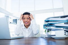 Businesswoman getting stressed at her desk Stock Photos