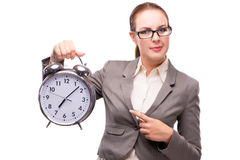 The businesswoman with giant alarm clock isolated on white Royalty Free Stock Images