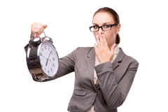The businesswoman with giant alarm clock isolated on white Stock Photography