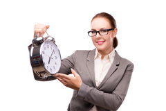 The businesswoman with giant alarm clock isolated on white Stock Image