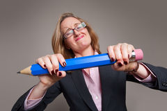 Businesswoman giant blue pencil Royalty Free Stock Photos