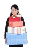 Businesswoman with gift boxes. Businesswoman carrying gift boxes isolated on white Royalty Free Stock Images
