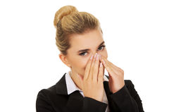 Businesswoman giggles covering her mouth with hand Royalty Free Stock Photo