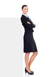 Businesswoman girl standing by blank billboard Royalty Free Stock Photos