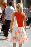 Businesswoman - girl walking down the street Stock Image