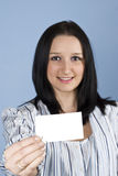 Businesswoman give a blank card royalty free stock photography