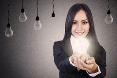 Businesswoman give bright idea Stock Photo