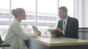 Businesswoman give financial profit report document with manager, businessman reading report with marketing or agreement