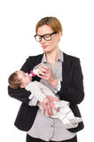 Businesswoman gives a baby the bottle Royalty Free Stock Photos