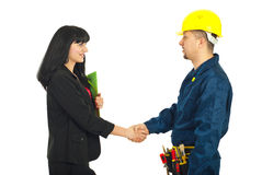 Businesswoman gives handshake with worker Royalty Free Stock Photography