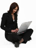 Businesswoman giving all her attention to her work Stock Photo