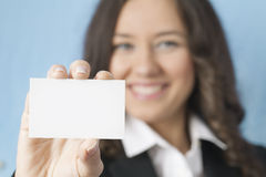 Businesswoman giving blank business card Stock Photo