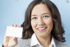 Businesswoman giving blank business card Royalty Free Stock Photography