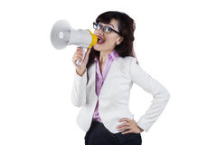 Businesswoman giving command through megaphone Royalty Free Stock Photos