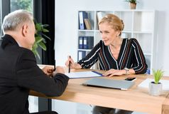 Businesswoman giving contract to partner Royalty Free Stock Photo