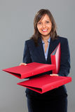 Businesswoman giving a folder Stock Photography