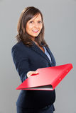 Businesswoman giving a folder Royalty Free Stock Photography