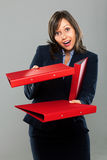 Businesswoman giving folders Royalty Free Stock Photo