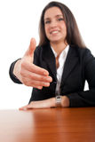 Businesswoman giving handshake white background Royalty Free Stock Photos