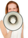 Businesswoman giving instructions with a megaphone Stock Photography