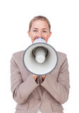 Businesswoman giving instructions with a megaphone Stock Image