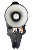 Businesswoman giving instructions with a megaphone Stock Photo