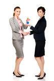 Businesswoman giving a key to her partner. Royalty Free Stock Photography