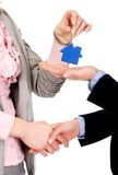 Businesswoman giving a key to her partner. Stock Photography