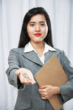 Businesswoman giving keys Stock Photos