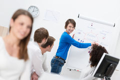 Businesswoman giving a motivational presentation Stock Images