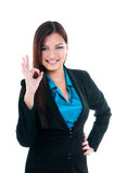 Businesswoman Giving OK Gesture Stock Photography