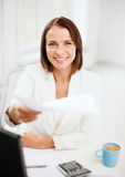 Businesswoman giving papers in office Royalty Free Stock Photography