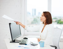 Businesswoman giving papers in office Royalty Free Stock Images