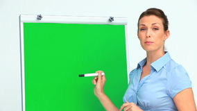 Businesswoman giving a presentation with a board stock video