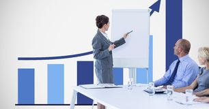 Businesswoman giving presentation to colleagues against graph. Digital composite of Businesswoman giving presentation to colleagues against graph Royalty Free Stock Photography