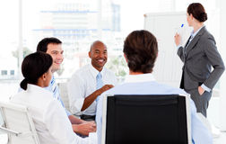 Businesswoman giving a presentation to her team Stock Image