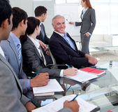 Businesswoman giving a presentation to her team Royalty Free Stock Images