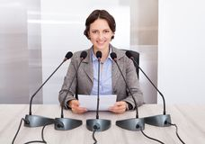 Businesswoman giving speech Stock Photos